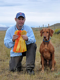 Vizsla Remus with proud Papa Aaron celebrating an AKC Master Hunter qualify and two Open Gun Dog placements in major retrieving stakes